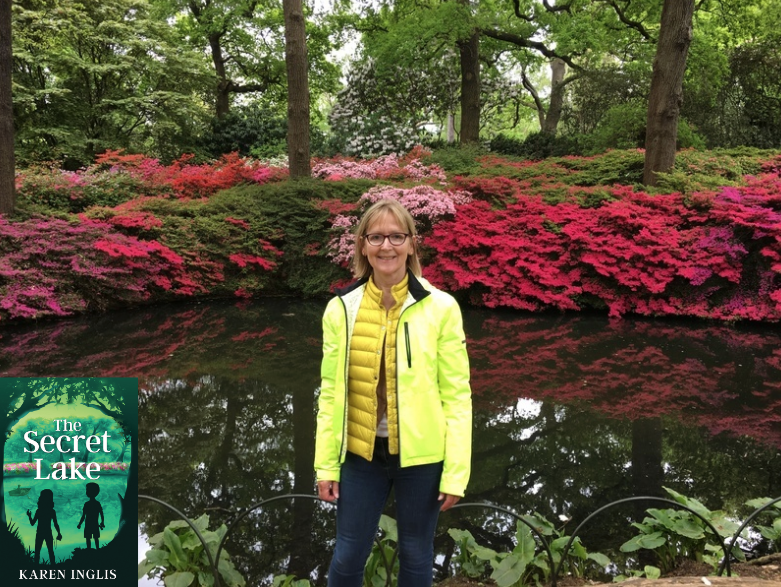 Image of Karen Inglis standing in front of Still Pond, Isabella Plantation with pink azaleas