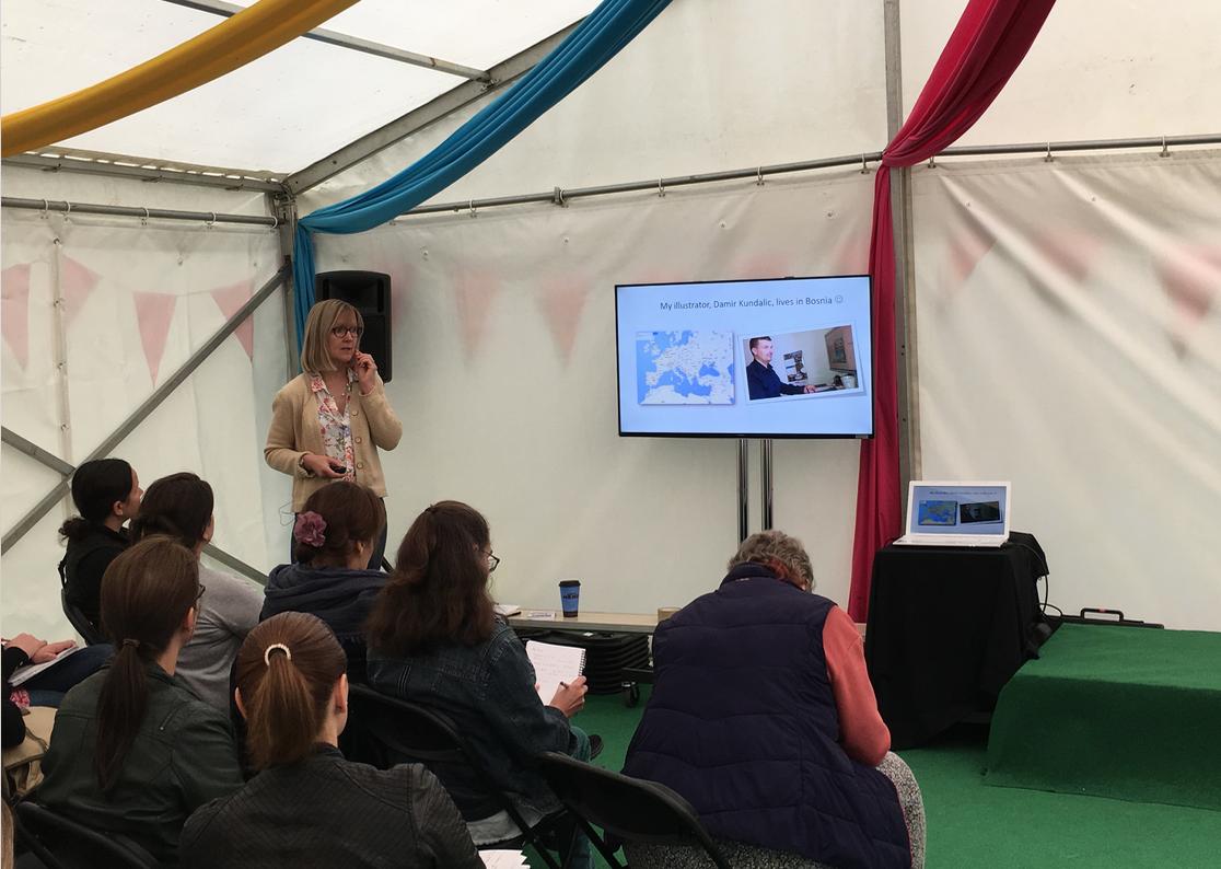 Karen Inglis giving a talk - audience and slides
